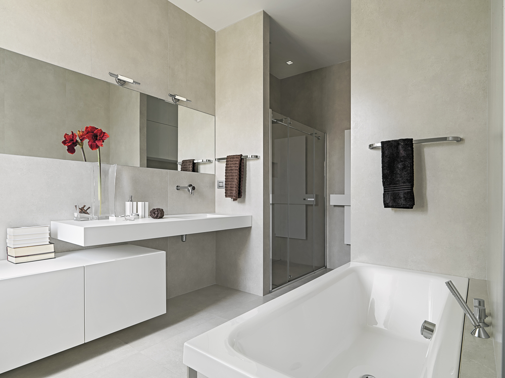 panoramic view of a modern bathroom with washbasin and bathtub